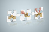 Jigsaw, hand of person with stack coins isolated on white background. Financial analyzing concept.