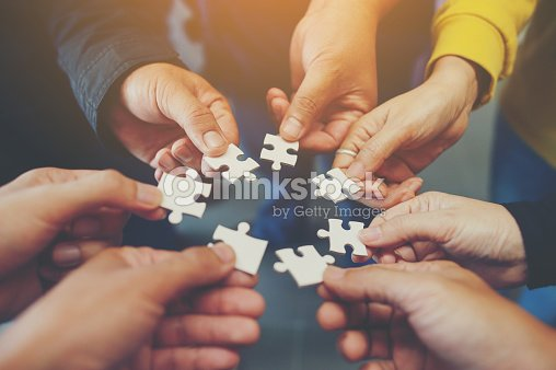 Jigsaw is a harmony among the group will not be impossible. : Stock Photo