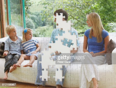 Jigsaw of family with dad pieces missing