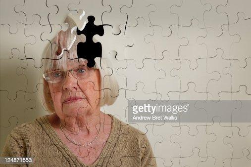 Jigsaw puzzle, of a senior woman, falling apart
