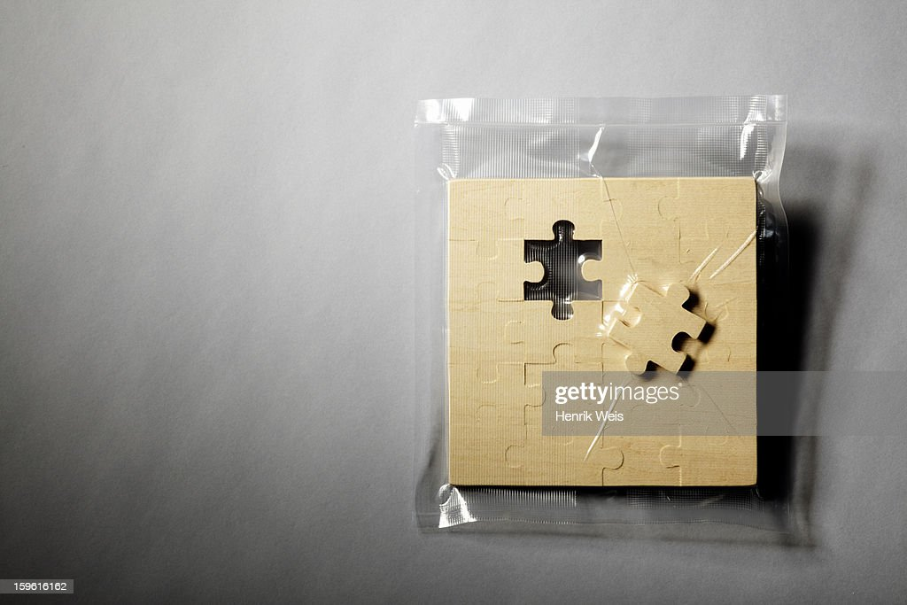 Jigsaw puzzle shrink wrapped in plastic