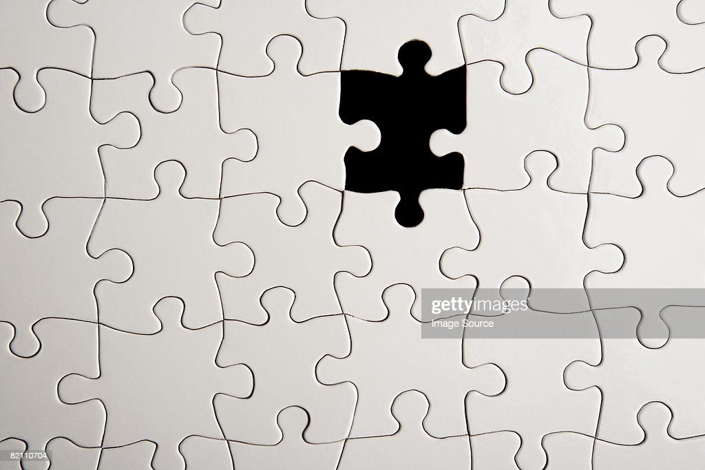Jigsaw puzzle with missing piece : Stock Photo