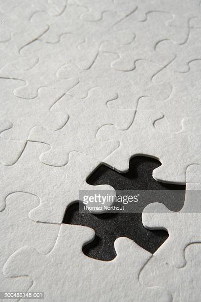 Jigsaw puzzle with one piece missing, elevated view