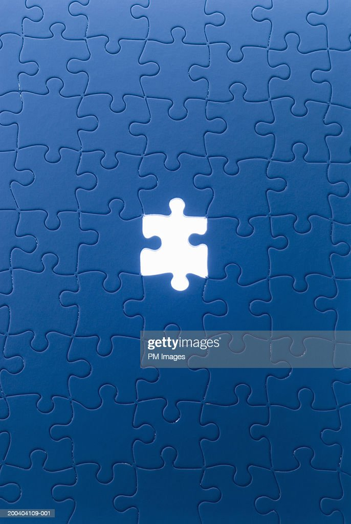 Jigsaw puzzle with piece missing : Stock Photo