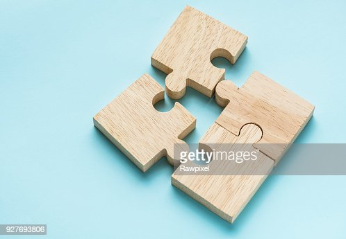 Jigsaw teamwork concept macro shot : Stock Photo
