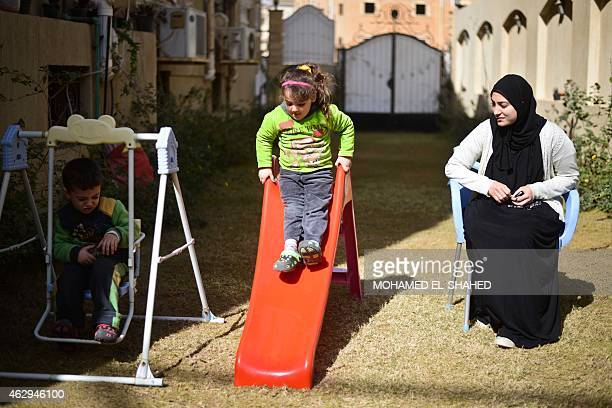 Jihan Rashid the wife of alJazeera's Egyptian producer Baher Mohamed looks after their children Hazem and Fairouz on February 5 2015 in the capital...