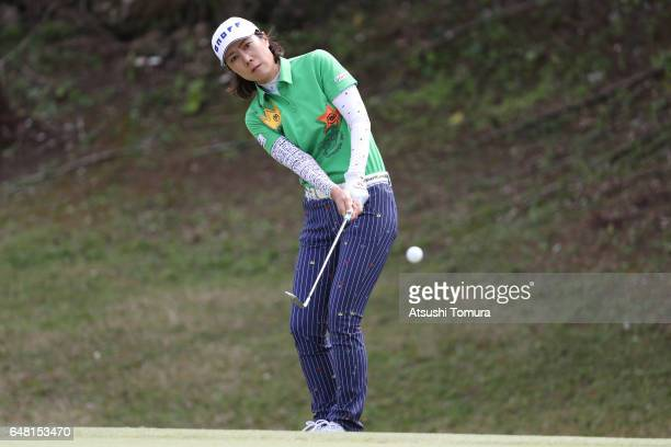 JiHee Lee of South Korea chips onto the 14th green during the final round of the Daikin Orchid Ladies Golf Tournament at the Ryukyu Golf Club on...
