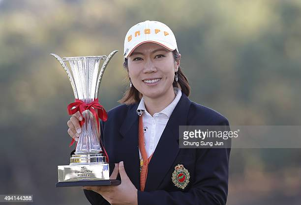 JiHee Lee of South Korea lifts the winner's trophy during a ceremony following the Nobuta Group Masters GC Ladies at the Masters Gold Club on October...