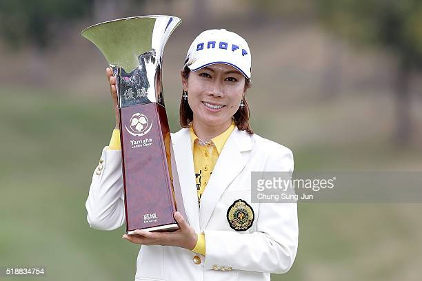 JiHee Lee of South Korea lifts winner's trophy during a ceremony following the YAMAHA Ladies Open Katsuragi at the Katsuragi Golf Club Yamana Course...