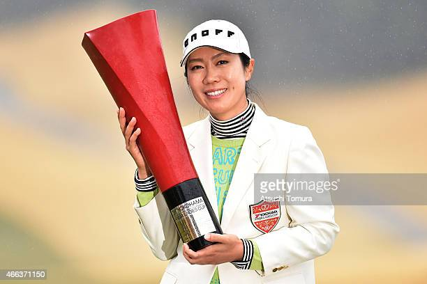 JiHee Lee of South Korea poses with the trophy after winning the Yokohama Tyre PRGR Ladies Cup at the Tosa Country Club on March 15 2015 in Konan...