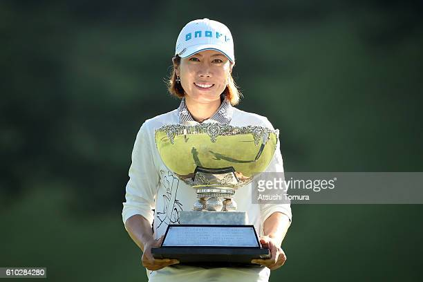 JiHee Lee of South Korea poses with the trophy after winning the Miyagi TV Cup Dunlop Ladies Open 2016 at the Rifu Golf Club on September 25 2016 in...