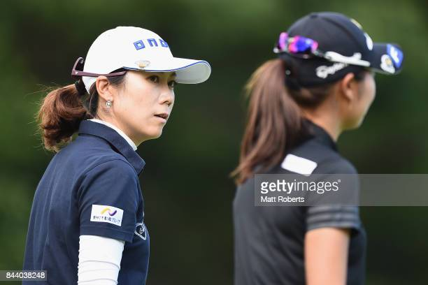 JiHee Lee of South Korea speaks with Ayaka Matsumori of Japan during the second round of the 50th LPGA Championship Konica Minolta Cup 2017 at the...