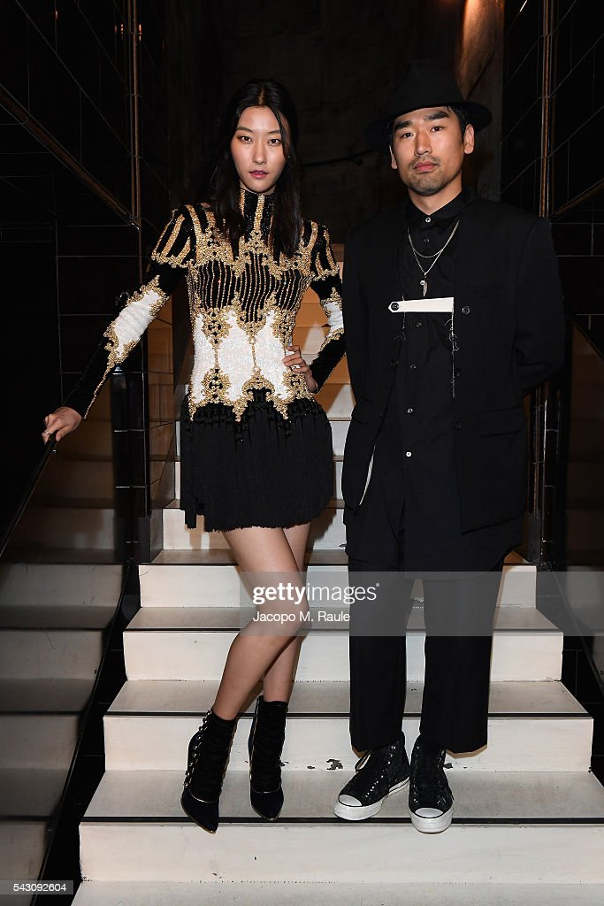Jihye Park and guest attend the Balmain Menswear Spring/Summer 2017 after party as part of Paris Fashion Week at Les Bains on June 25, 2016 in Paris, France.