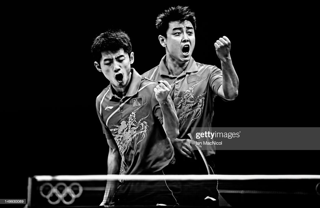 Jike Zhang and Hao Wang of China celebrate victory against Timo Boll and Bastain Steger of Germany in the doubles match of the men's team competition...