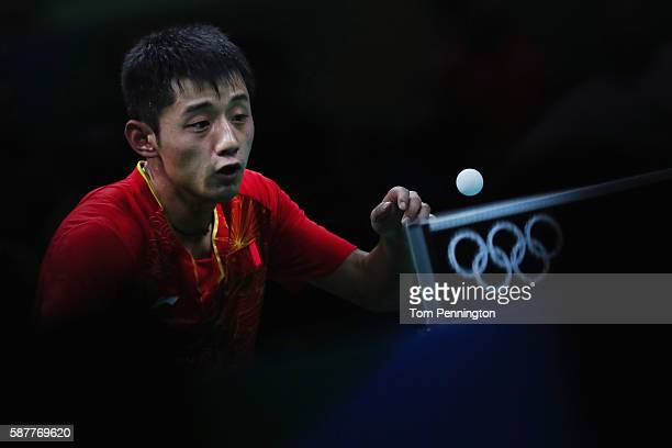 Jike Zhang of China competes against Koki Niwa of Japan during the Men's Singles Quarterfinal 4 Table Tennis on Day 4 of the Rio 2016 Olympic Games...