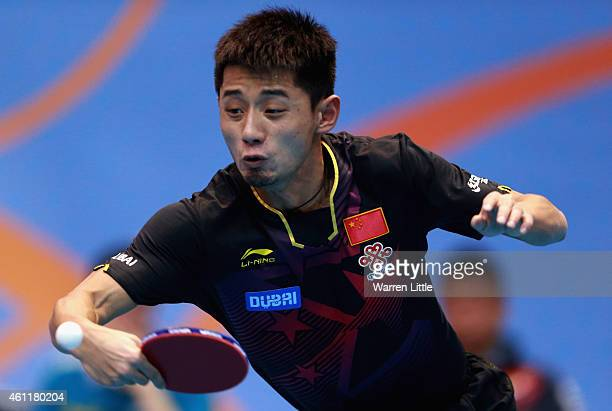 Jike Zhang of China in action against Robert Gardos of Austria during day one of the ITTF World Team Cup at the Al Nasr Sports Club on January 8 2015...