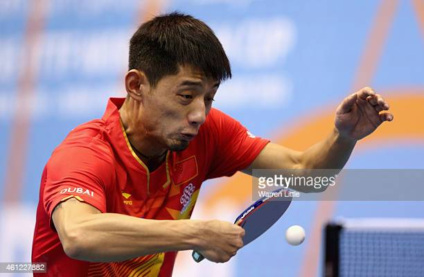 Jike Zhang of China in action during the quarter final match against Gustavo Tsuboi of Brazil on day two of the 2015 ITTF World Team Cup at Al Nasr...