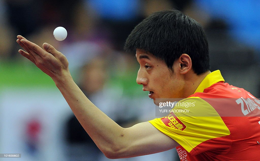 Jike Zhang of China services to Seiya Kishikawa of Japan during the men's semi final at the 2010 World Team Table Tennis Championships in Moscow on May 29, 2010.
