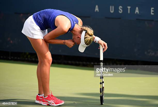 Jil Belen Teichmann of Switzerland against Isabelle Wallace of Great Britain during their junior girls' first round match on Day Seven of the 2014 US...