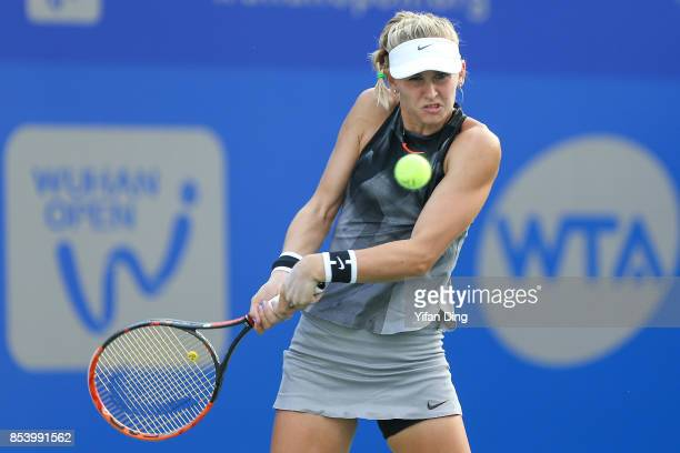 Jil Teichmann of Switzerland plays a backhand during the second round Ladies Singles match against Dominika Cibulkova of Slovakia on Day 3 of 2017...