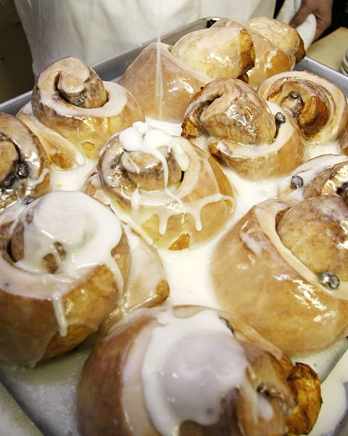 Icing Is Drizzled Over A Fresh Batch Of Sticky Buns At The Good