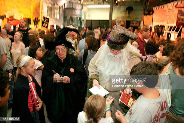 Maureen and David Butler of Portland sign autographs as Professors Manerva McGonagle and Albus Dumbledore respectively for Harry Potter fans at...