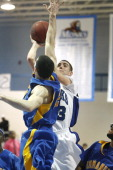 St Joe's Tyler Kelley makes a shot over Emmanuel Andres Bustamante during the GNAC Championship game Saturday February 28 2009 in Standish