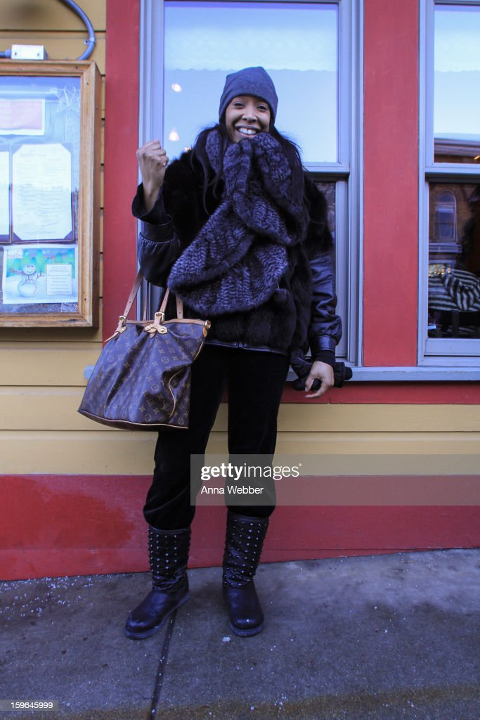 Jill Connors, actor from Los Angeles, wearing a knit mink scarf, Rosendor Evan fox coat, Seven velvet pants, Vintage boots, and a Louis Vuitton bag on January 17, 2013 on the streets of Park City, Utah.
