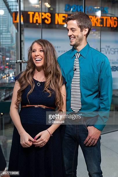 Jill Duggar Dillard and husband Derick Dillard visit 'Extra' at their New York studios at HM in Times Square on October 23 2014 in New York City
