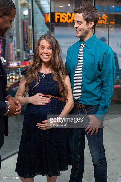 Jill Duggar Dillard and husband Derick Dillard visit 'Extra' at their New York studios at HM in Times Square on October 23 2014 in New York City