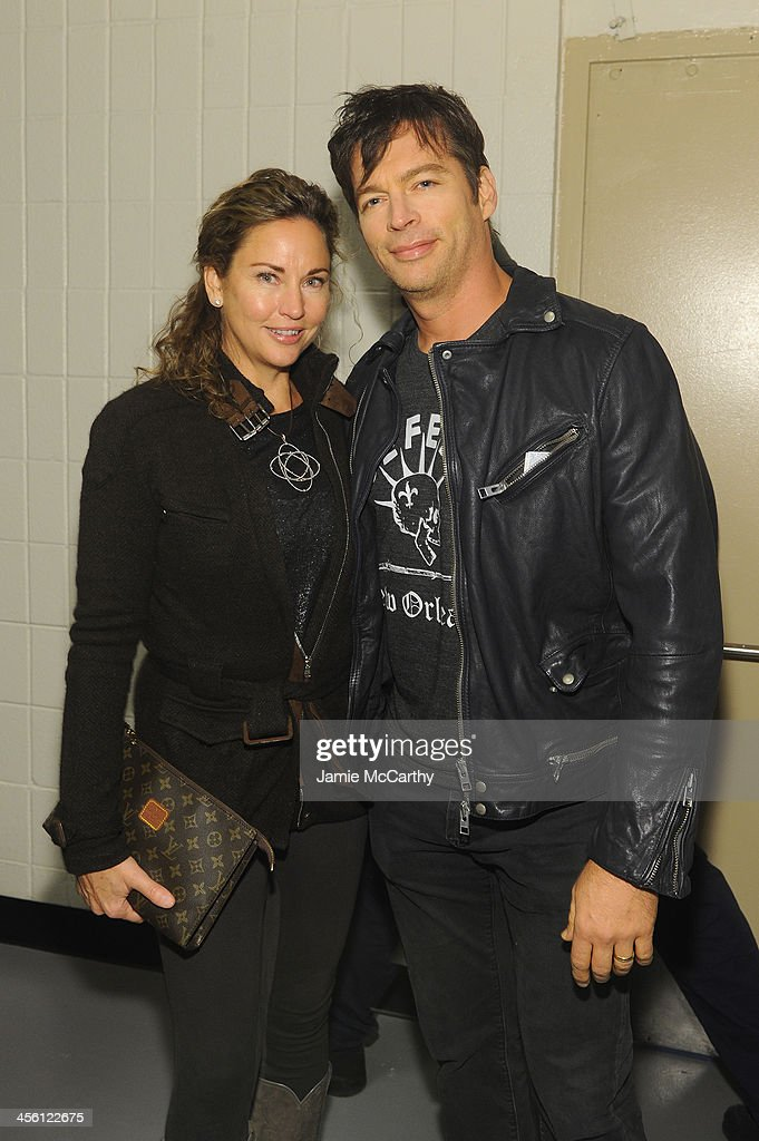 Jill Goodacre and Harry Connick Jr. pose backstage at Z100's Jingle Ball 2013, presented by Aeropostale, at Madison Square Garden on December 13, 2013 in New York City.
