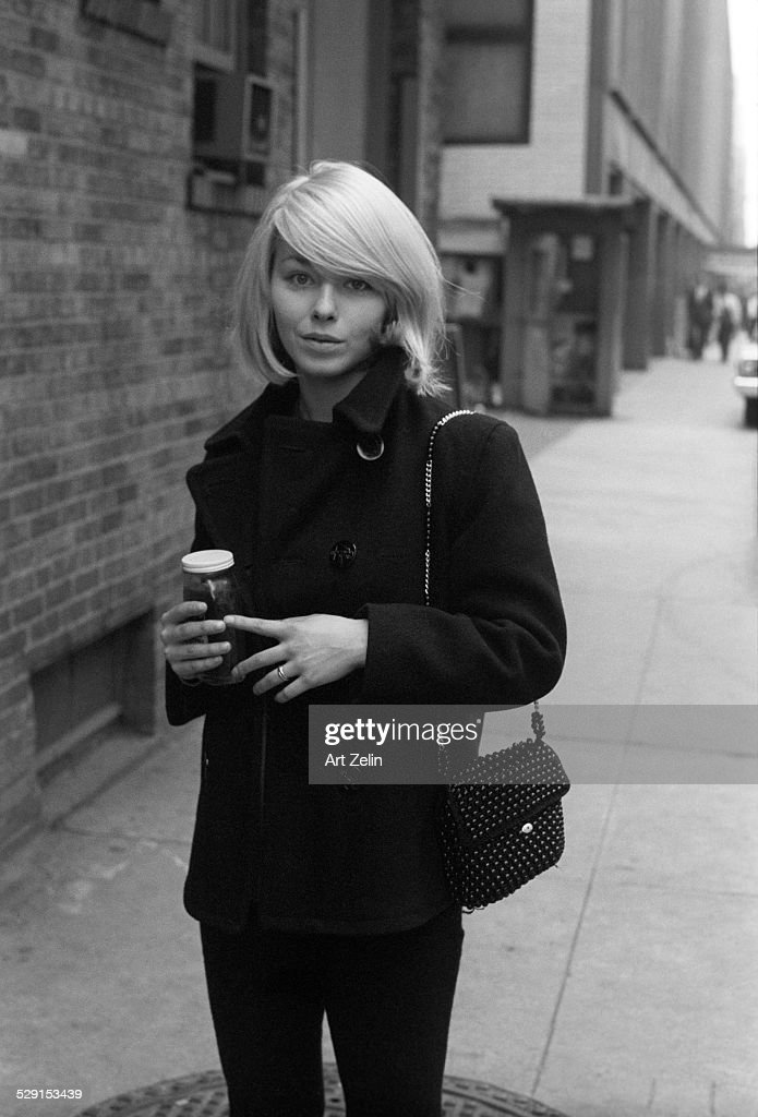 <a gi-track='captionPersonalityLinkClicked' href=/galleries/search?phrase=Jill+Haworth&family=editorial&specificpeople=224879 ng-click='$event.stopPropagation()'>Jill Haworth</a> walking on the street carrying a jar; circa 1970; New York.