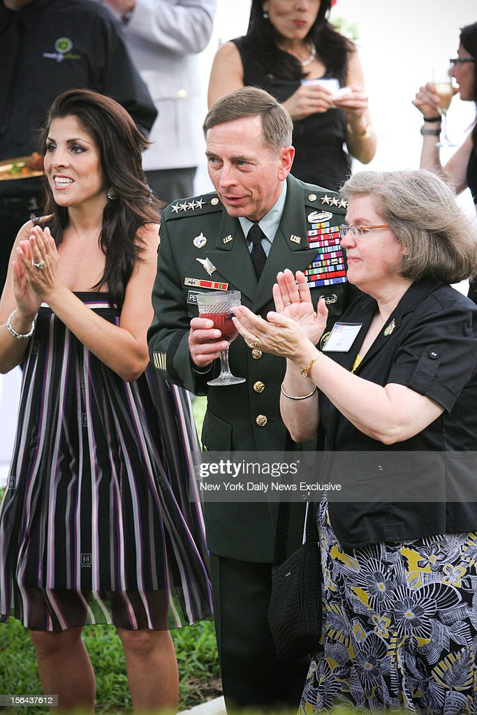 Jill Kelley, General David Petraeus and Holly Petraeus (l.- r.) attending event in which Gen. Petraeus was presented with community service award at the home of Jill and Scott Kelley during summer of 2011.