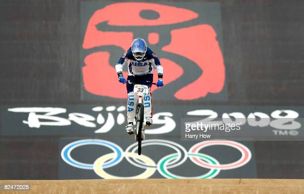 Jill Kintner of the United States competes in the Women's Seeding phase of the BMX competition at the Laoshan Bicycle Moto Cross Venue during Day 12...
