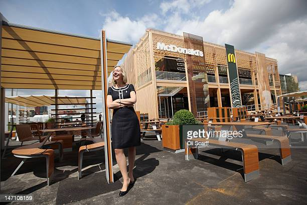 Jill McDonald the Chief Executive Officer of McDonald's UK poses for a photograph in front of the world's largest McDonald's restaurant which is...