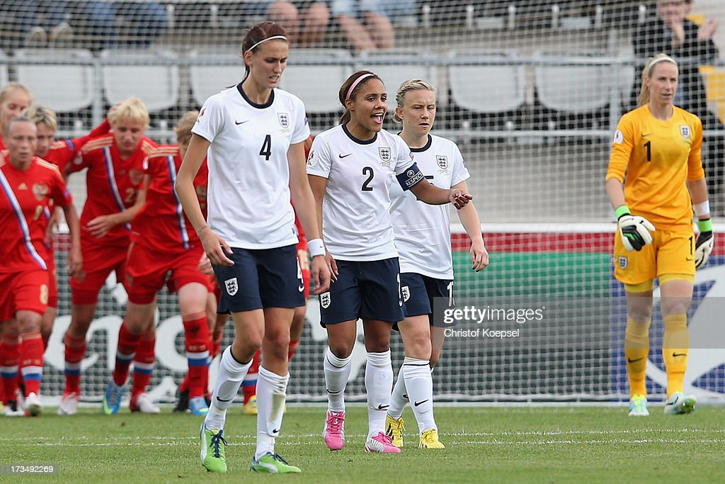 Jill Scott, Alex Scott, <a gi-track='captionPersonalityLinkClicked' href=/galleries/search?phrase=Fara+Williams&family=editorial&specificpeople=2309371 ng-click='$event.stopPropagation()'>Fara Williams</a> and <a gi-track='captionPersonalityLinkClicked' href=/galleries/search?phrase=Karen+Bardsley&family=editorial&specificpeople=5988222 ng-click='$event.stopPropagation()'>Karen Bardsley</a> of England look dejected after the first goal of Russia during the UEFA Women's EURO 2013 Group C match between England and Russia at Linkoping Arena on July 15, 2013 in Linkoping, Sweden.