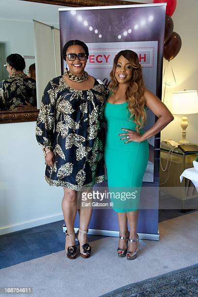 Jill Scott and Niecy Nash pose for a photo as Niecy Nash celebrates the release of her new book 'It's Hard to Fight Naked' at Luxe Rodeo Drive Hotel...