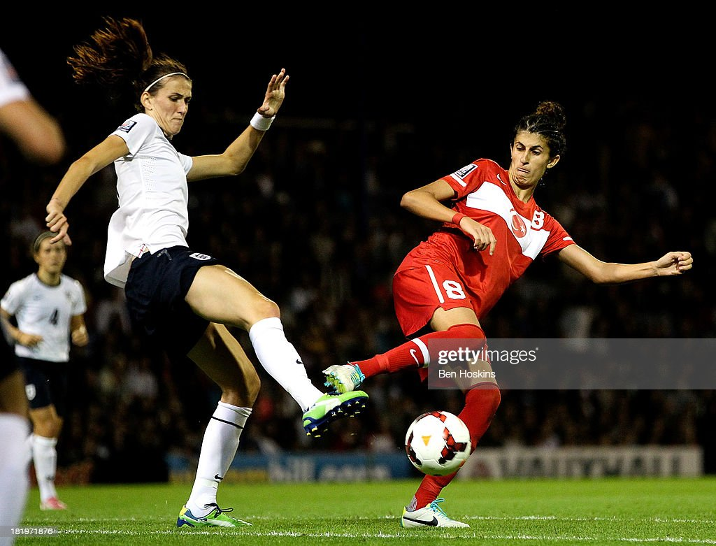 Jill Scott of England battles for posession with Yagmur Uraz of Turkey during the FIFA Women's World Cup 2015 Group 6 Qualifier match between England and Turkey at Fratton Park on September 26, 2013 in Portsmouth, England.