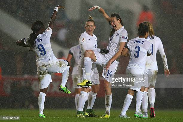 Jill Scott of England celebrates after scoring alongside Eniola Aluko and Laura Bassett during the UEFA Women's Euro 2017 Qualifier match between...