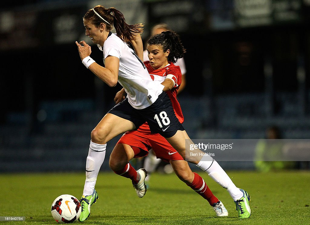 Jill Scott of England holds off the challenge of Pinar Yalcin of Turkey during the FIFA Women's World Cup 2015 Group 6 qualifier between England and Turkey at Fratton Park on September 26, 2013 in Portsmouth, England.