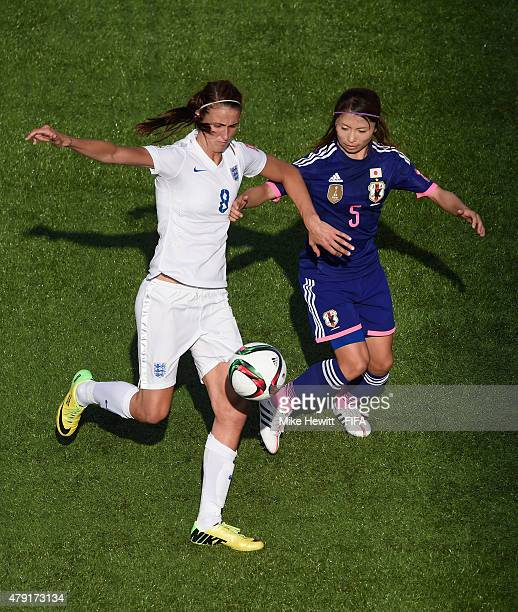 Jill Scott of England is challenged by Aya Sameshima of Japan during the FIFA Women's World Cup 2015 Semi Final match between Japan and England on...