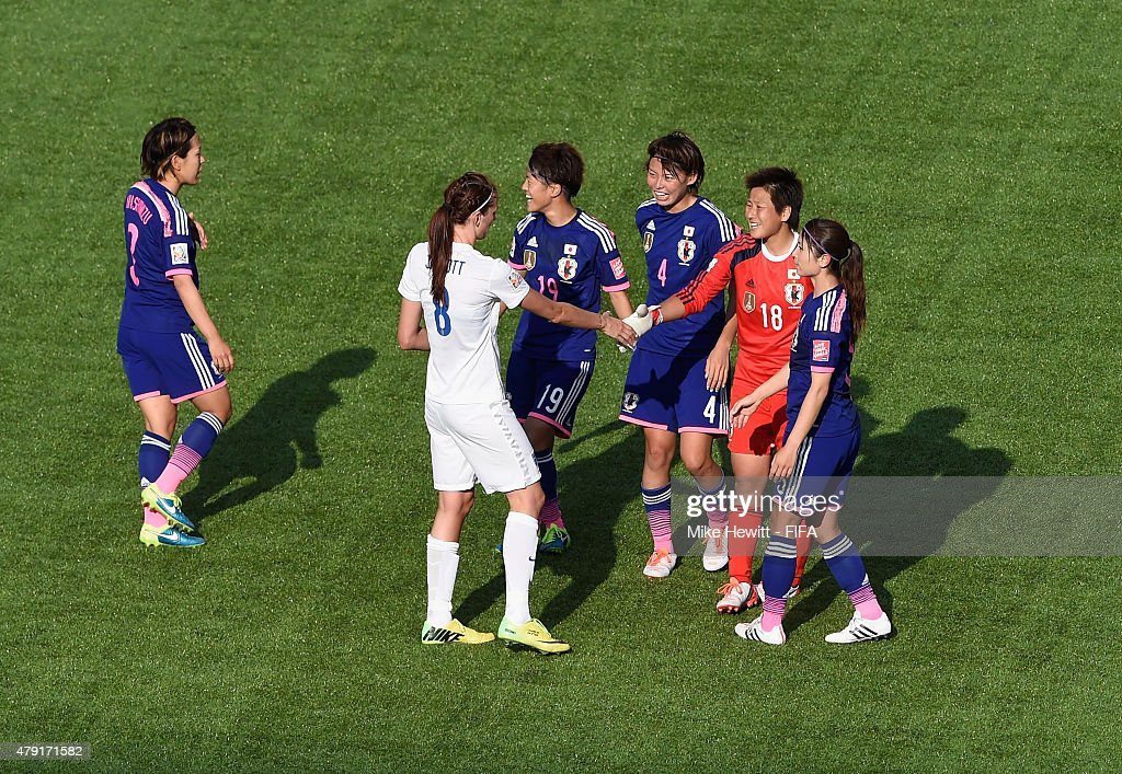 Jill Scott of England sportingly congratulates the Japan players at the end of the FIFA Women's World Cup 2015 Semi Final match between Japan and England on Canada Day at Commonwealth Stadium on July 1, 2015 in Edmonton, Canada.