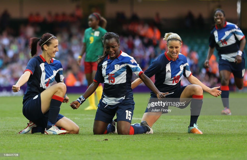 Jill Scott (L) of Great Britain celebrates scoring with team mates Eniola Aluku and Kelly Smith of Great Britain during the Women's Football first round Group E Match between Great Britain and Cameroon on Day 1 of the London 2012 Olympic Games at Millennium Stadium on July 28, 2012 in Cardiff, Wales.