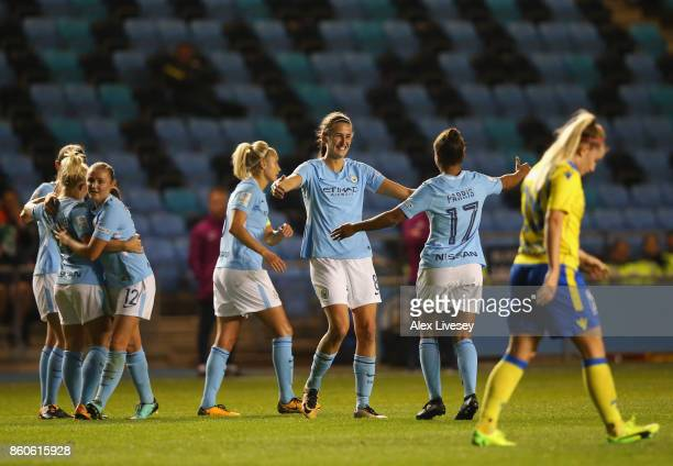 Jill Scott of Manchester City celebrates with Nikita Parris after scoring their second goal during the UEFA Women's Champions League match between...