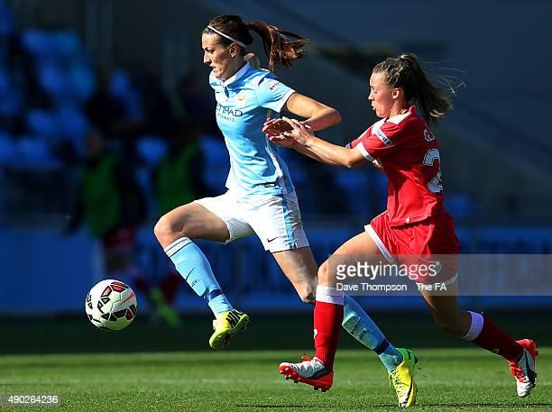 Jill Scott of Manchester City holds off Georgia Evans of Bristol Academy Women during the Women's Super League match between Manchester City and...