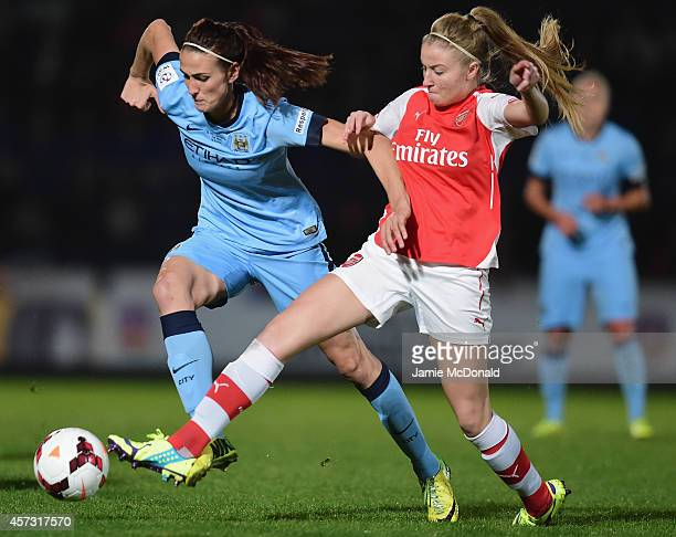 Jill Scott of Manchester City Ladies battles with Leah Williamson of Arsenal Ladies during the Continental Cup Final between Arsenal Ladies and...