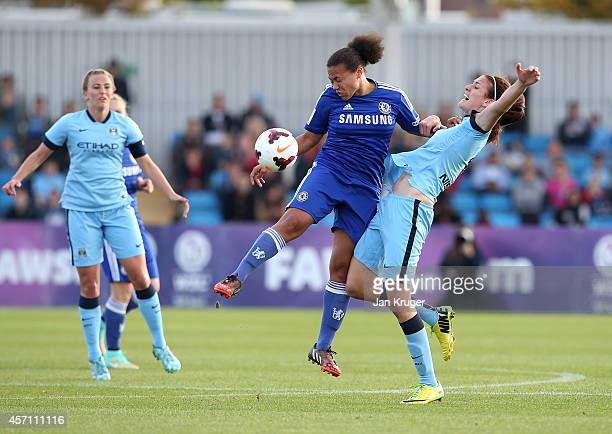 Jill Scott of Manchester City Women battles with Drew Spence of Chelsea Ladies for her goal during the WSL match between Manchester City Women and...