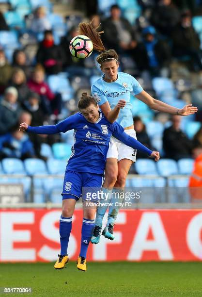 Jill Scott of Manchester City Women battles with Hayley Ladd of Birmingham City Ladies during the FA WSL Continental Tyres Cup between Manchester...