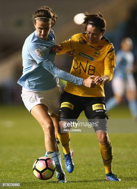 Jill Scott of Manchester City Women holds off a challenge from Isabell Bachor of LSK Kvinner during the UEFA Women's Champions League match between...