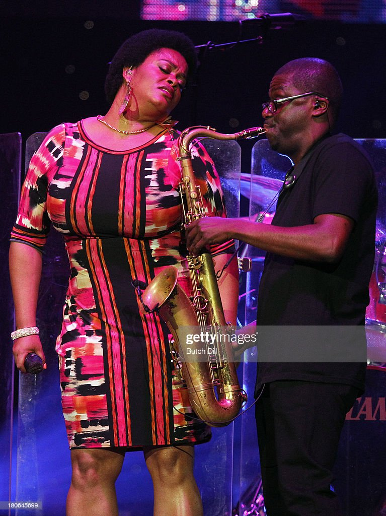 Jill Scott performs during the BBVA Compass Concert for Human Rights hosted by Jamie Foxx at the Birmingham Jefferson Convention Center on September 14, 2013 in Birmingham, Alabama.